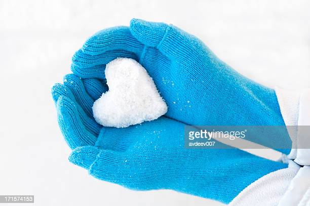 Woman's hands holding snowheart.