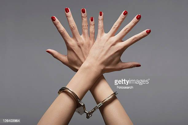 Woman's hands in handcuffs (close-up)