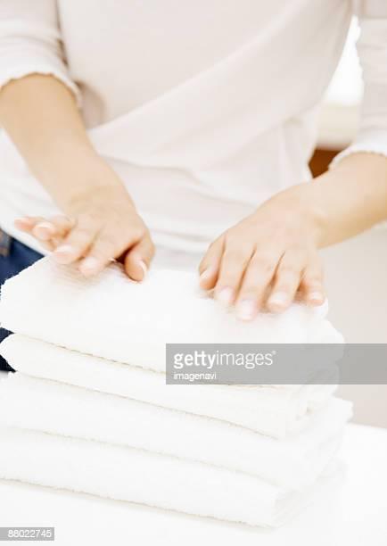 Woman's hands of folding towel