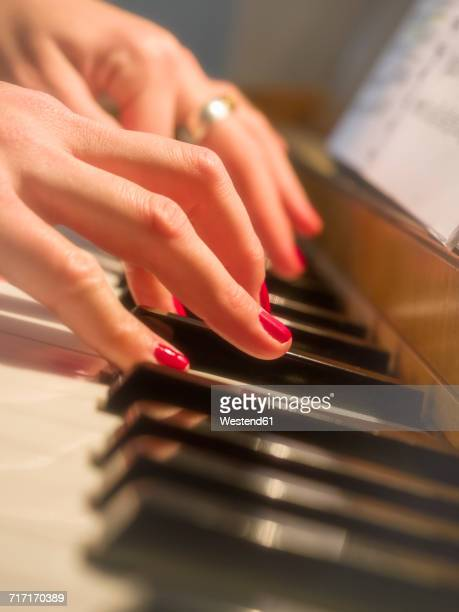 Womans hands on piano keyboard