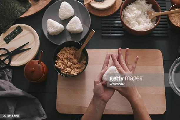 Womans hands preparing Onigiris