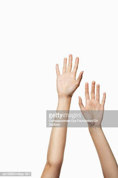 Woman's hands reaching up