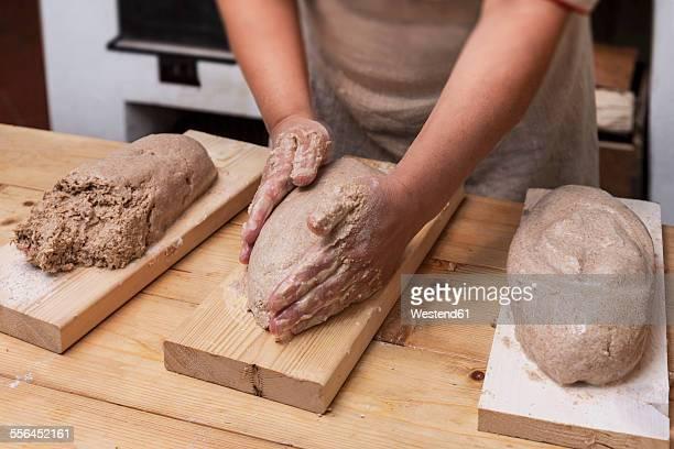 woman's hands shaping raw loaf of bread - estonia fotografías e imágenes de stock