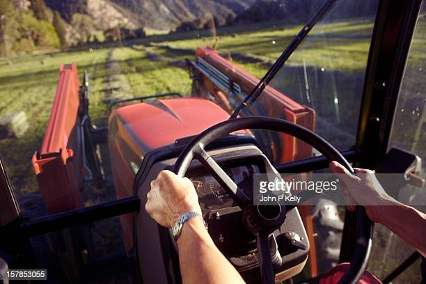 woman's hands steering tractor - agricultural machinery stock pictures, royalty-free photos & images