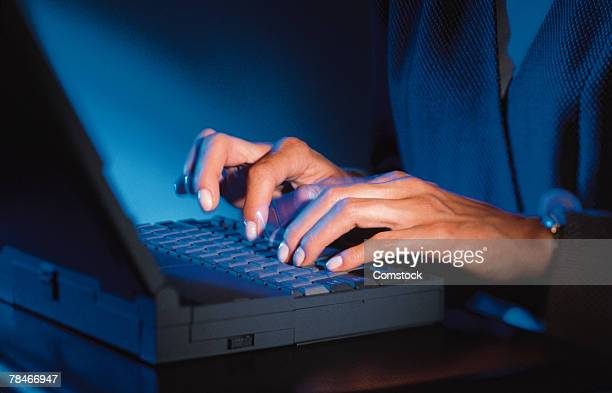 Woman's hands typing on laptop computer