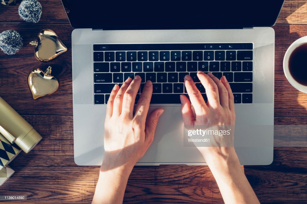 Woman's hands typing on laptop, top view : Stock Photo