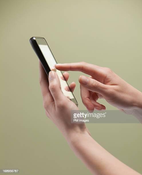 Woman's hands using smart phone