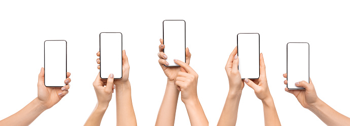 Woman's hands using smartphone with blank screen over white background 1181604224