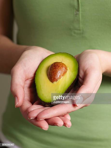Woman's hands with avocado