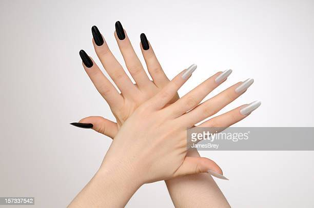 woman's hands with black and white nails - slapping stock pictures, royalty-free photos & images