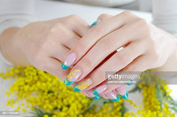 Woman's hands with floral nail art design