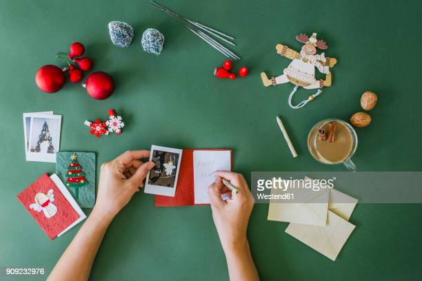 Woman's hands writing Christmas card