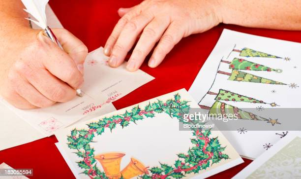 Womans Hands Writing Christmas Cards