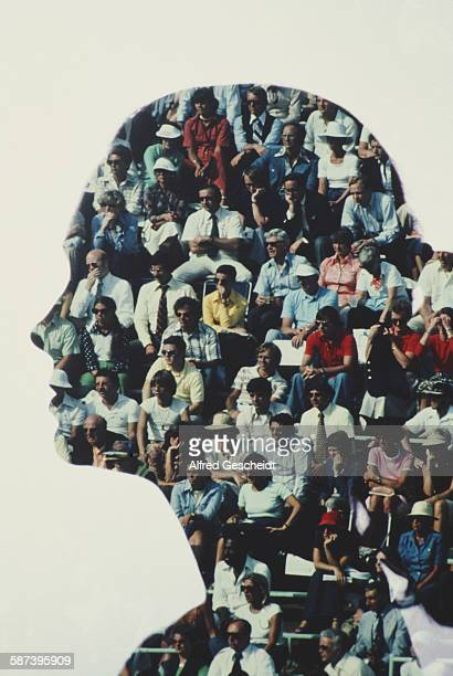 A woman's head filled with spectators at an event 1978