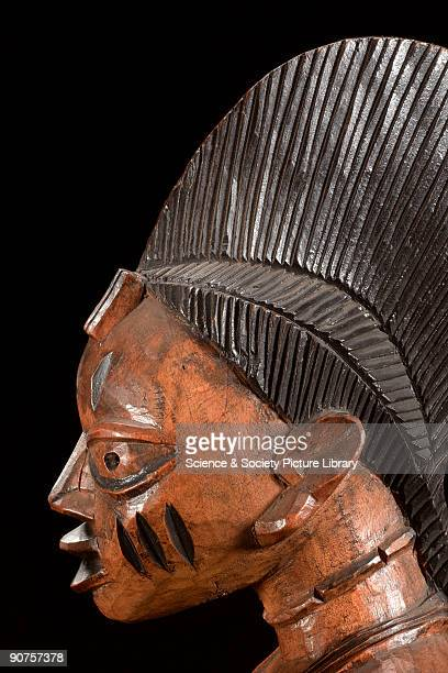 Woman�s head on an adjella Ifa made by the Yoruba people in the form of a woman carrying a child kneeling in respect to Ifa the god of divination...