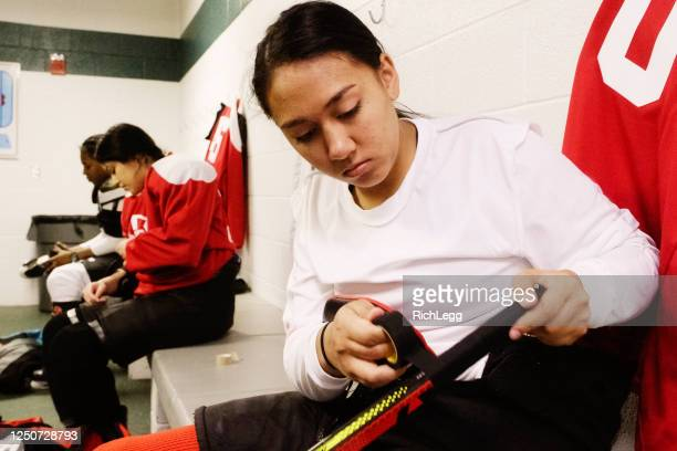 woman's hockey team in a locker room - ice hockey uniform stock pictures, royalty-free photos & images