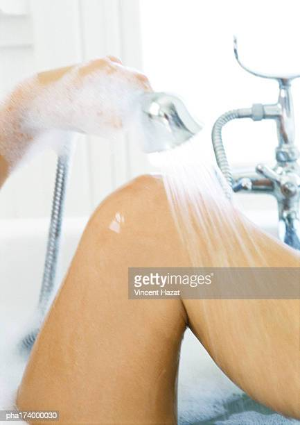 Woman's knee in bathtub, close-up