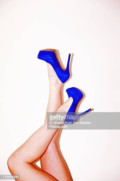 Woman's Legs and Bright Blue Shoes