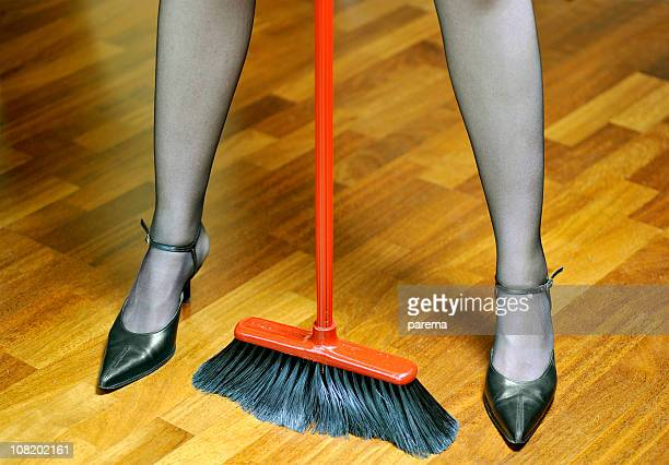 Woman's legs and broom