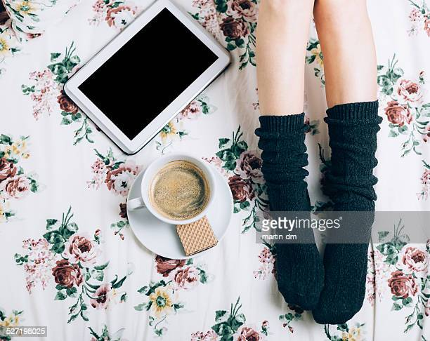 Woman's legs and coffee