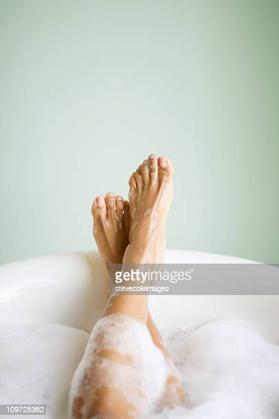 woman's legs and feet in bathtub with bubbles - taking a bath stock pictures, royalty-free photos & images