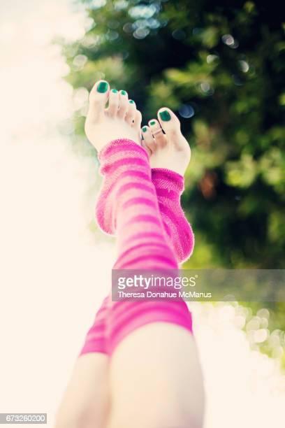woman's legs and feet - レッグウォーマー ストックフォトと画像