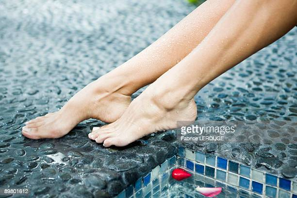 woman's legs at the poolside - womens pretty feet stock photos and pictures