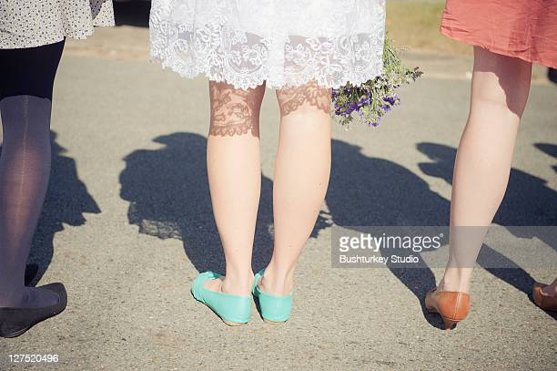 Woman's legs im colourful stockings and shoes
