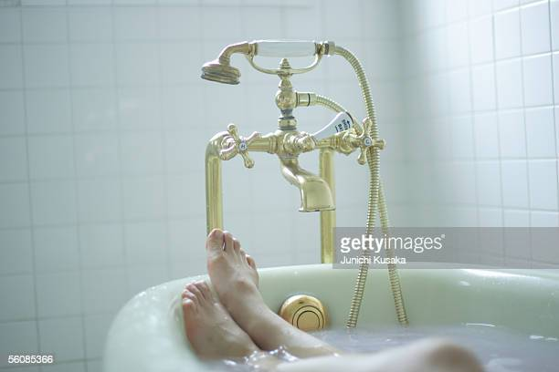 Woman's legs in bathtub