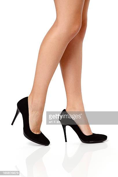 woman's legs in black high heels - beautiful legs in high heels stock photos and pictures