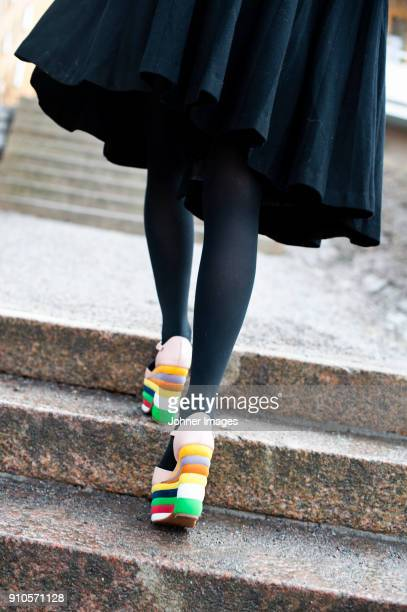 womans legs in black tights climbing stairs - tights stock pictures, royalty-free photos & images