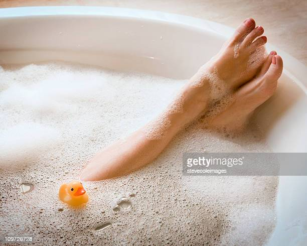 Woman's Legs in Bubble Bath with Ducky