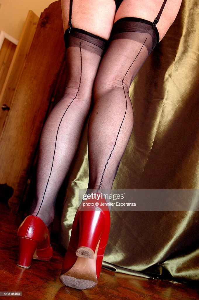 Womans Legs In Classic Black Seamed Stockings Stock Photo