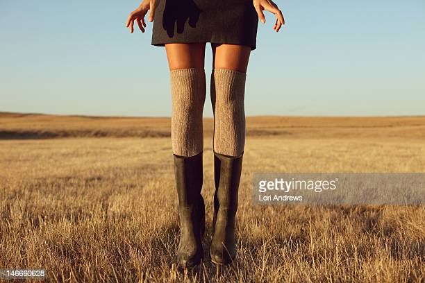 woman's legs in knee high socks and rubber boots - kneesock stock pictures, royalty-free photos & images