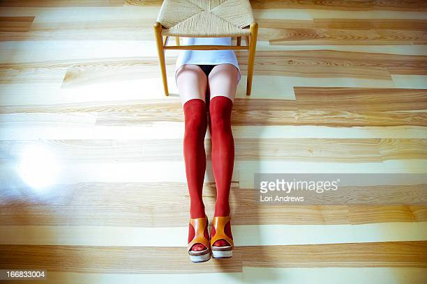 Womans legs in knee high socks from above