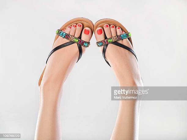 woman's legs in the air - sandal stock pictures, royalty-free photos & images