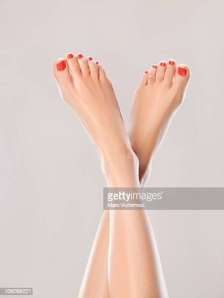 woman's legs in the air - beautiful female feet stock photos and pictures