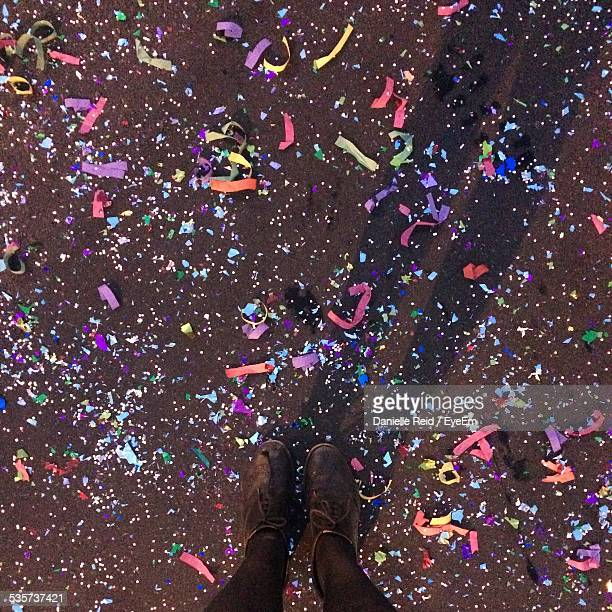 Womans Legs On Ground Covered With Confetti