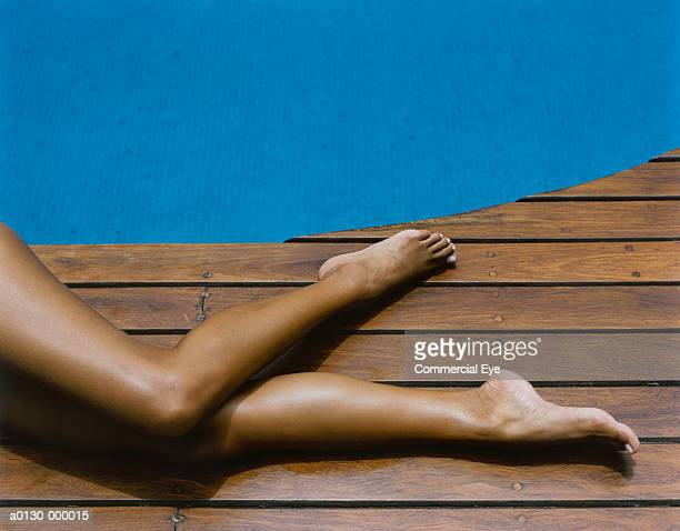 Woman's Legs on Pool Deck