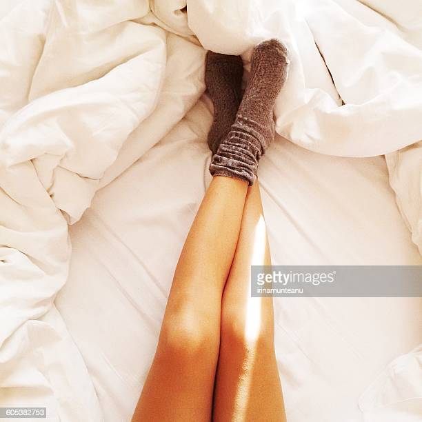 Woman's legs on white sheets