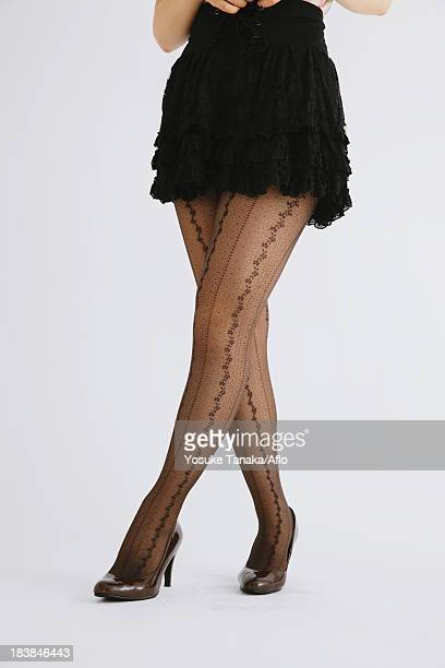 woman's legs - japanese short skirts stock photos and pictures