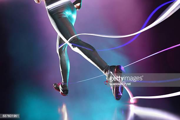 Woman's legs, running and leaving streaks of light