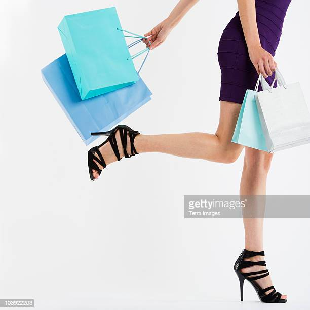 Woman's legs walking with shopping bags