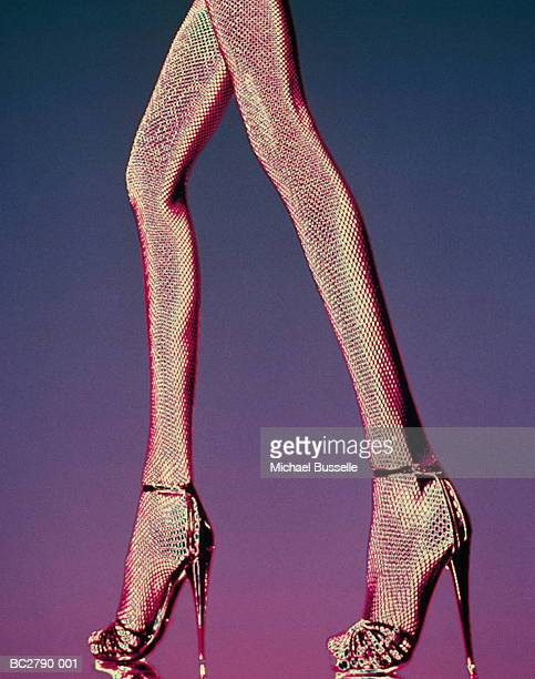 Woman's legs wearing fishnet tights and stilettos (Enhancement)