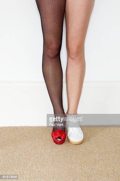 womans legs with one leg in stockings the other we