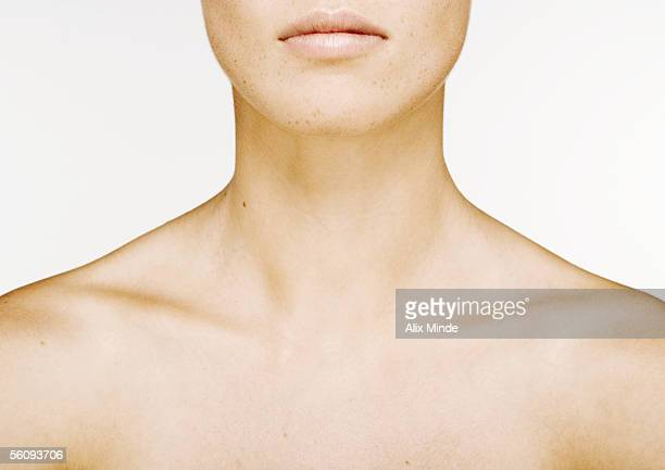 woman's lower face, neck and bare upper chest - clavicle stock photos and pictures