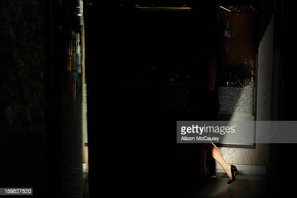 CONTENT] A woman's lower leg is all that's visible as she disappears into dark dense shadows Her leg is trim and shapely and on her visible foot is a...