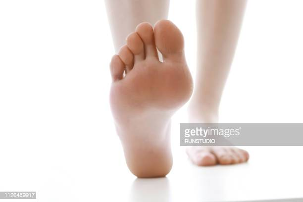 woman's lower legs and feet, close-up - feet stock pictures, royalty-free photos & images