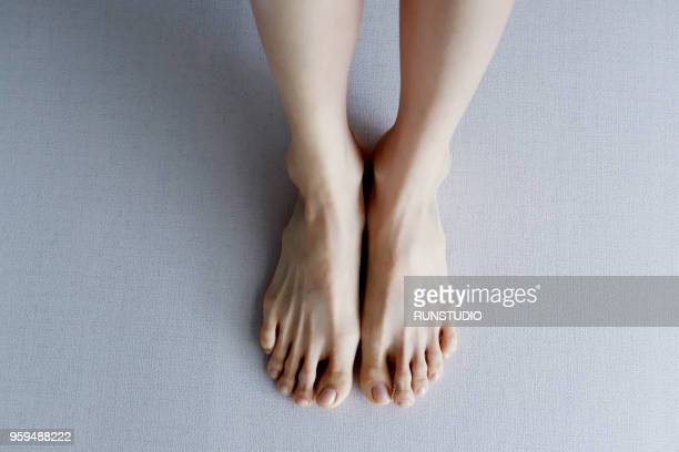 woman's lower legs and feet, close-up - japanese women feet stock photos and pictures