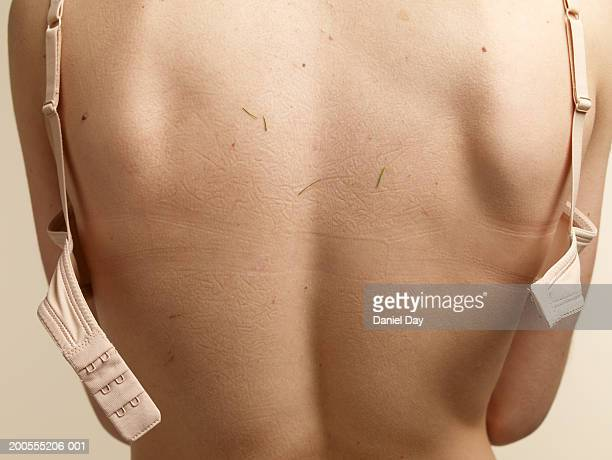 Woman's naked back, mid section, close-up